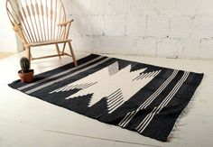Woven Rug from Joinery NYC. http://www.joinerynyc.com/shop/living/woven-rug-in-black-white-one-l.html