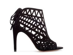 This caged boots make an aesome alternative to pointy party courts and will add instant edge to the girliest of party dresses.