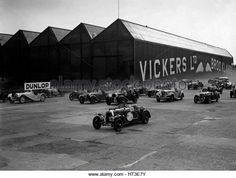 Cars racing at the MCC Members Meeting, Brooklands, 10 September 1938. Artist: Bill Brunell. - Stock Image