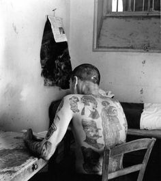 Atelier Robert Doisneau | Site officiel // Nanterre.1952. ( http://www.gettyimages.co.uk/detail/news-photo/amanfrom-behindwithbigtattoos-news-photo/121515817
