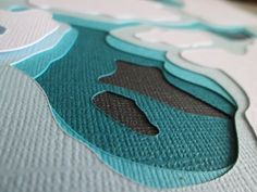 This water topography, was cut from thick paper cardstock, using a cnc router with a Rockcliff drag knife bit,