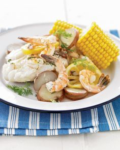 "Grilled New England Seafood ""Bake"": Maine's sunny coast is as close as your patio when you break into foil packets of buttery shrimp, cod, potatoes, and corn."