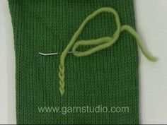 DROPS Technique Tutorial: Embroidery, How to embroider chain stitches. In this DROPS video we show how to embroider chain stitches on a knit...