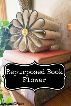 Repurposed Book Flower. Roll the vintage books which were destined for recycling into this stunning and chic decorative flower for your home display.
