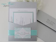 I like these colors. Damask Wedding Invitation Suite in Tiffany Blue by OneLovePaperie, $1.90