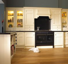 Black appliances with cream cabinets -- uh oh...maybe no green...this is beautiful!!