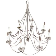 Handsome Tole Iron Eight-Arm Chandelier with Matching Pair of Sconces   From a unique collection of antique and modern chandeliers and pendants  at https://www.1stdibs.com/furniture/lighting/chandeliers-pendant-lights/