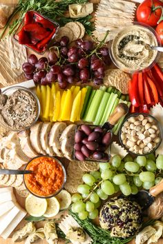 A beautiful spread of fruits and vegetables arranged to create a plant-based charcuterie board thats perfect for your next party.