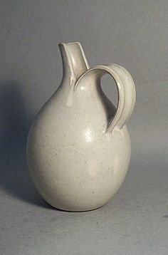 Saxbo pitcher. throw a tall spout & split for handle