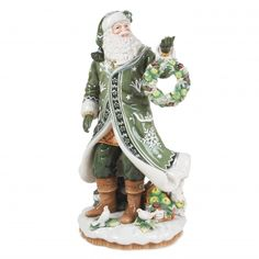 The Winter Garden Santa Figurine is robed in lush green complemented with antique white details. This elegant ceramic Santa stands proudly holding a holiday wreath, surrounded by his forest friends and a basket of fruit. The details and quality of this piece make it one of the most luxurious Fitz and Floyd Santa Figurines to date!