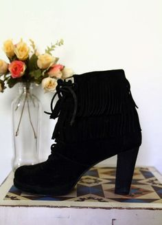 bota de franjas