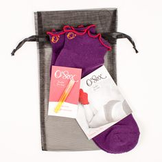 The classic purple Venus Sox with a sample of the luscious O'Scent, bundled  in a reusable organza bag. Venus socks are made in sock size 9-11, which  will fit most.