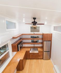 With its extra width, the tiny house features a spacious kitchen with bamboo countertops, Norcraft cabinets, and an additional eating/desk area.