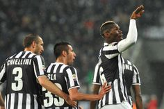 Paul Pogba (R) of Juventus celebrates after scoring the opening goal during the Serie A match between Juventus and Bologna FC at Juventus Ar...
