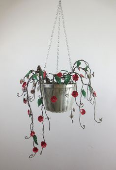 Forever Blooming Barbed Wire Hanging Plant by The Dusty Raven Gallery, via Flickr