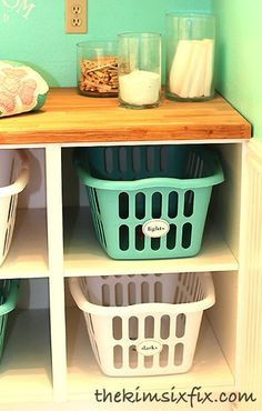 Laundry basket cubbies made from Ikea Cabinets without doors.  The shelves are adjustable so you can use it with any size baskets!!  SO SMART!