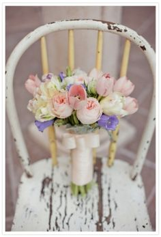 tulips and rustic weathered chair. I love tulips in bouquets, table decor and pretty much everywhere. This little bouquet brightens the simplicity of the chair it's sitting on. Tulip Wedding, Spring Wedding, Wedding Flowers, Wedding Bouquet, Wedding Dress, Flowers For You, Beautiful Flowers, Romantic Flowers, Vintage Flowers