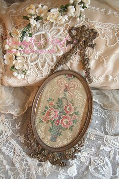 take a vintage photo hanger and a favorite lace or material...