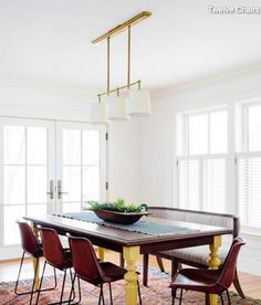 …to add some visual interest to an all-white dining room, such as this one in Boston designed byTwelve Chairs, attention to detail can make a world of difference. The yellow-painted legs of the dining table add a pop of color that connects to the brass light fixture. Modern leather chairs from Jayson Homecreate a nice juxtaposition with the antique settee also used for seating.