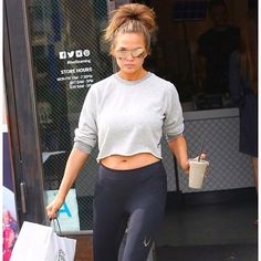 Baby bump? Check. Killer shades? Double check. Awesome leggings? Triple check. @chrissyteigen has it going ON.