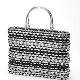 "This stylish 11 by 8 inch bag made of strips of soda pull tabs and tire inner tube has two solid metal handles and a zipper closure. The black cotton lining has an internal zip pocket. Meet the Artisans      The founders of BIO Imaginarte take the mantra ""Reduce, Reuse, and Recycle"" to heart. The focus of BIO when it began in 1992 was educating Mexico in the need to protect and restore the environment. Working with women who live in several villages as an aspect of its education efforts, BIO…"