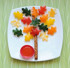 Cute fall tree made with pepper slices, cucumber slices, marble cheese slices and a pretzel stick -- need to find mini leaf cutters!