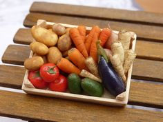 Miniature vegetable crate featuring potatoes, tomatoes, carrots, parsnips, avocados, aubergine, eggplant.  Handmade in 12th scale by Paris Miniatures - Emmaflam and Miniman