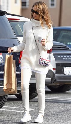 Jessica Alba in a white turtleneck, white jeans, sneakers and printed Chanel bag - click through for more celebrity-inspired winter outfit ideas