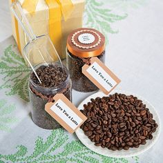 """Step 1: In a mixing bowl, combine equal parts of ground coffee and raw sugar. About 4 oz. of each will fill two jars once combined.  Step 2: Add olive oil as desired until you reach a moist consistency  If giving as gift you can create in a word document """"Coffee Body Scrub"""" and """"Love You a Latte"""".  Next fill the jars with your coffee body scrub and seal with lid. ;)"""
