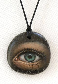 Realistic eye painted stone pendant by Magics of Creation