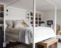 Modern white four poster bed with antiques- Darryl Carter