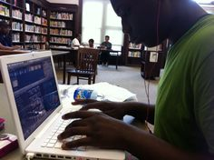 Dounia Project Student in the Bronx, NY working on his video project