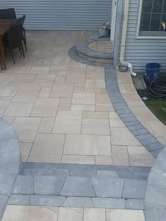 Pati-WOW! This beautiful patio installed by Paradise Pavers Pond Landscaping uses Cambridge Pavingstones with ArmorTec.