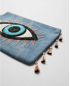 Whether on vacation, out to dinner or just running errands, this denim, tassel-trimmed pouch keeps keys, cards and makeup all in one fun place. Diy Clutch, Clutch Bag, Tote Bag, Diy Purse, Beaded Embroidery, Hand Embroidery, Handmade Bags, Evil Eye, Cool Eyes