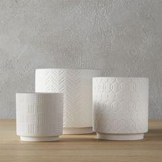 Shop 3-Piece White Planter Set. Diamond, chevron, abstract basket weave––three unique textures emerge on a trio of matte white stoneware. Perfect for indoor planting. 3-piece white loom planter set is a CB2 exclusive.