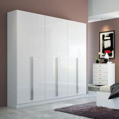 Perfect for smaller bedrooms, the Eldridge He/She Armoire from Manhattan Comfort offers ample wardrobe space. Each end section has 2 drawers, 2 accessories compartments and a closet rod. The center section another rod plus 5 storage compartments. Modern Wardrobe, Wardrobe Closet, Wardrobe Design, Closet Space, Closet Doors, Tv Armoire, Space Saving Storage, Adjustable Shelving, Wardrobes