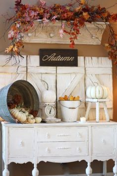 buffet table with galvanized pail, another pail painted white holding corn, stool with faux pumpkin, barn shutters as backdrop, shelf holding faux fall branches, lights on either side - I'm ready for the season to change