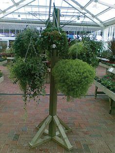 Hanging Basket Stand Hanging Basket Stand, Hanging Baskets, Diy Hanging, Hanging Plants, Windmill Hill, Garden Center Displays, Wooden Trellis, Big Deck, Trellis Panels