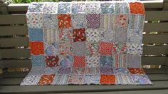 This colorful quilt is created with patterns from Moda's Serenade by Kate Spain collection, decorated with butterflies and quaint and cozy patterns, making it a wonderful gender neutral baby shower gift!  Measuring approximately 35x35 inches, this size blanket is perfect for your little one to cuddle under and can also be used as a play mat and for tummy time.