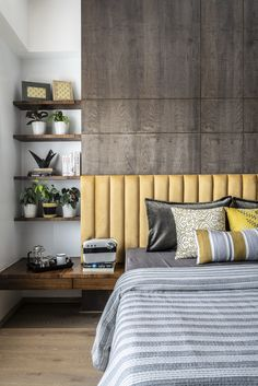 The plants and pops of bold mustard yellow in the headboard makes this master bedroom endearing. Design by studio Kreate. Bed Headboard Design, Room Design Bedroom, Bedroom Furniture Design, Bedroom Layouts, Headboards For Beds, Modern Luxury Bedroom, Master Bedroom Interior, Modern Master Bedroom, Luxurious Bedrooms