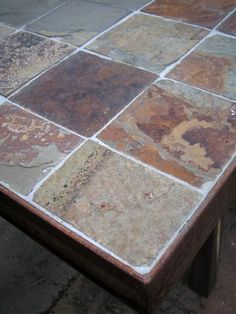 outdoor table with stone/slate tile insets. could use old paneled