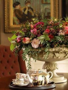 Great vignette with flowers in urn.