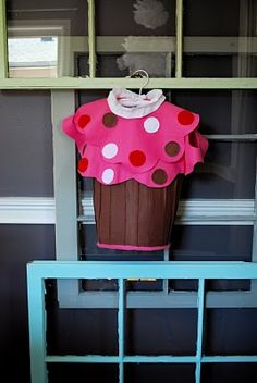 DIY - Pottery Barn Kids inspired No-see cupcake costume.   All you will need are these simple materials: 1) 1 yard of pink fleece 2) 1/2 yard brown felt 3) 6-8 pieces of small felt sheets (red, white, brown) 4) ruffled edging 5) scissors 6) hot glue 7) ribbon = $18.67