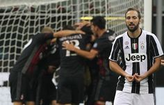 Gonzalo Higuain of Juventus FC shows his dejection at the end of the Serie A match between AC Milan and Juventus FC at Stadio Giuseppe Meazza on October 22, 2016 in Milan, Italy.