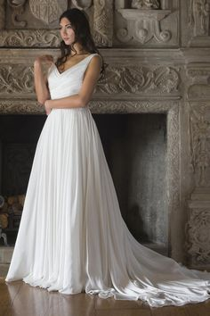 This flowy gown just arrived and is sure to steal bride's hearts! Call to make an appointment to see for yourself! @augustajones