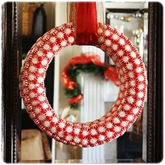 Peppermint DIY Christmas Wreath - See more beautiful DIY Chrsitmas Wreath ideas at DIYChristmasDecorations.net!