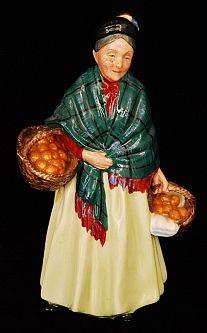 A Royal Doulton figurine, Orange Lady, HN1953.