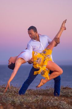 Salsa dance photo of professional salsa dancers, Takeshi Young & Alyssa Aguilar salsa dancing in the suset on the cliffs of Panther Beach in Santa Cruz, California. salsa dance pose | high resolution salsa dance images | salsa dance photography | salsa dancing pictures Dance Images, Salsa Dance, Dance Poses, Lets Dance, Dance Photography, Viera, Beautiful Images, Cool Photos, Around The Worlds
