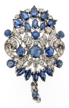 An Edwardian sapphire and diamond bar brooch, centred with a square shaped sapphire alternately set between a line of millegrain set diamonds and marquise shaped sapphires and within a rose cut diamond border in silver and gold. 7.5cm wide.