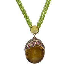 18K yellow gold pendant with 0.49 carat round brilliant cut diamonds, 6.88 carat amethysts, 2.10 carat tsavorites, 1.31 carat tourmalines, 288.00 carat peridots(necklace), 8.90 carat green amethyst and 53.00 grams of center amber. #michaeljohnjewelry